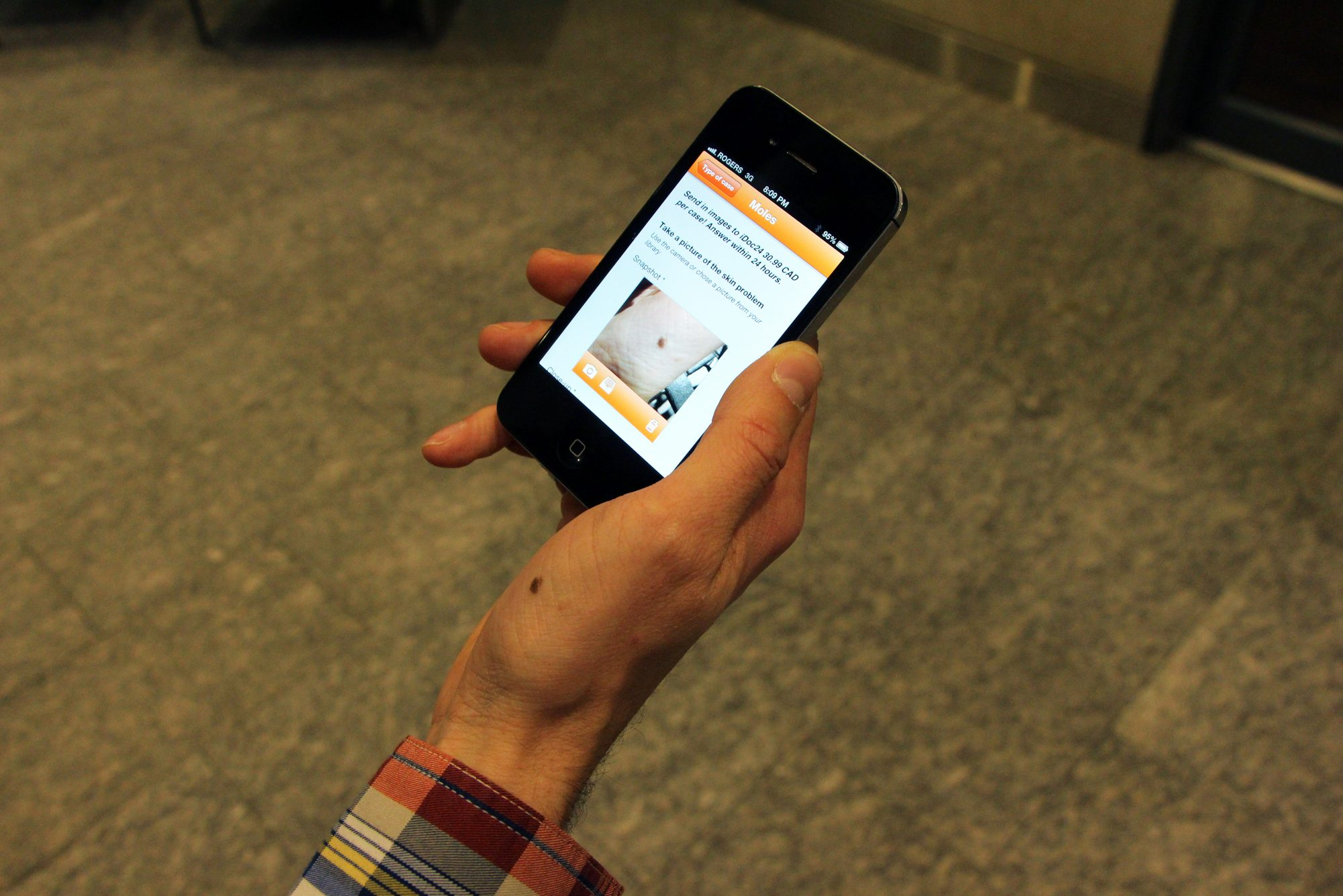 Submitting a photo to a licensed dermatologist for an assessment via the iDoc24 app. Photo by Maria Karpenko.