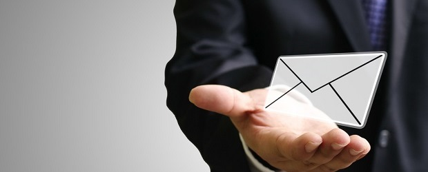 Hand holding email icon