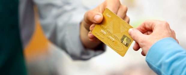 Image of someone passing credit card