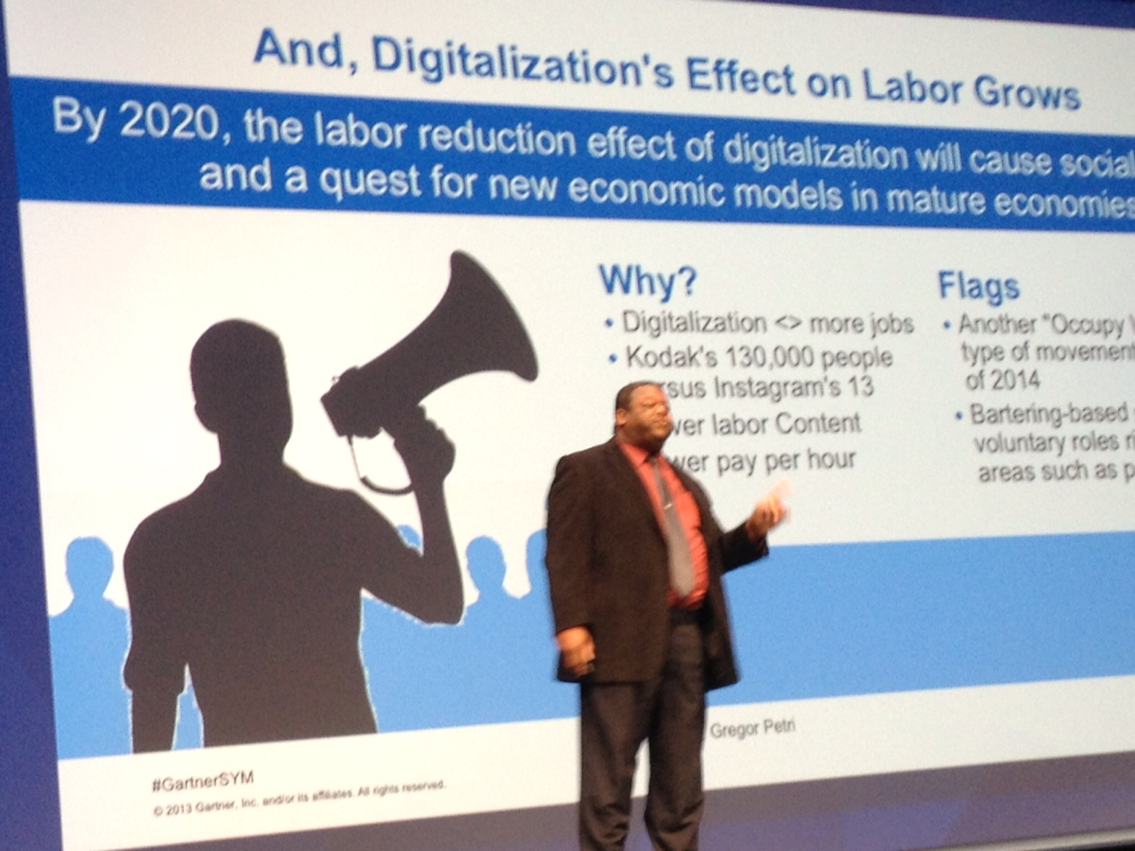 David Palmer addresses a crowd during a key note sessions at the Gartner Symposium in Orlando.