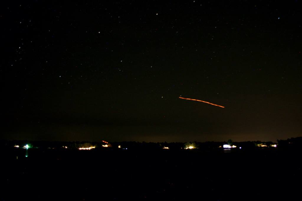 The results of a 30 second exposure on my Canon 600d. The streak is a paper lantern making its way across the skyline.