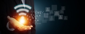 Image of man holding wifi symbol