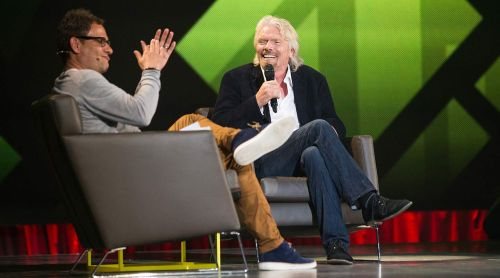 Sir Richard Branson (right) speaking at C2MTL in 2013. Jimmy Hamelin, photographer.