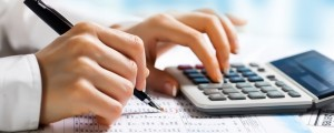 Image of someone using a calculator for budgeting