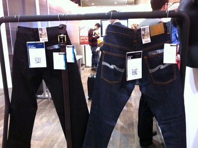 Sales tags with QR codes, attached to jeans at the Retail Collective at Dx3.