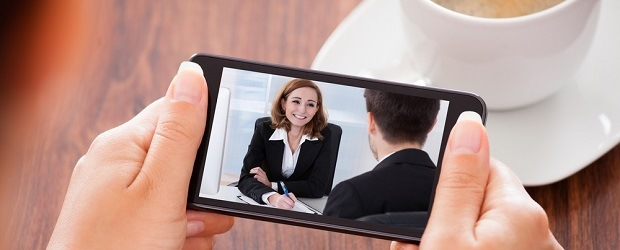 Image of someone watching mobile video