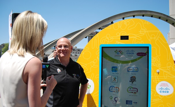 Jeff Seifert, chief technology officer for Cisco Canada, next to the interactive kiosk.