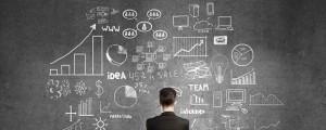 Man looking at wall of marketing metrics.
