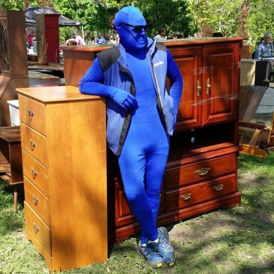 At 1-800-GOT-JUNK's Yardsale for the Cure event in 2014, a blue mascot surveys some of the cabinets for sale.