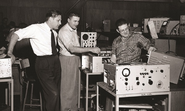 Barney Oliver (left), who served as HP's director of research and development for three decades, checks out a new scope at HP Labs in 1966 alongside Peter Lacy (center) and George Mathers (right).