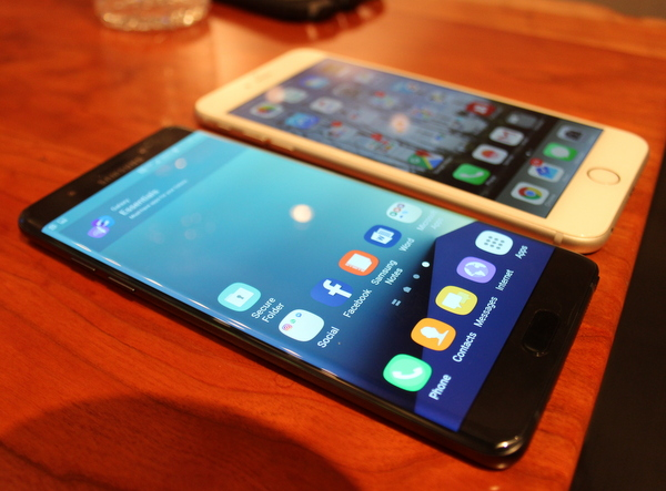 The Note 7 is similar in size to Apple's iPhone 6S, also seen here.