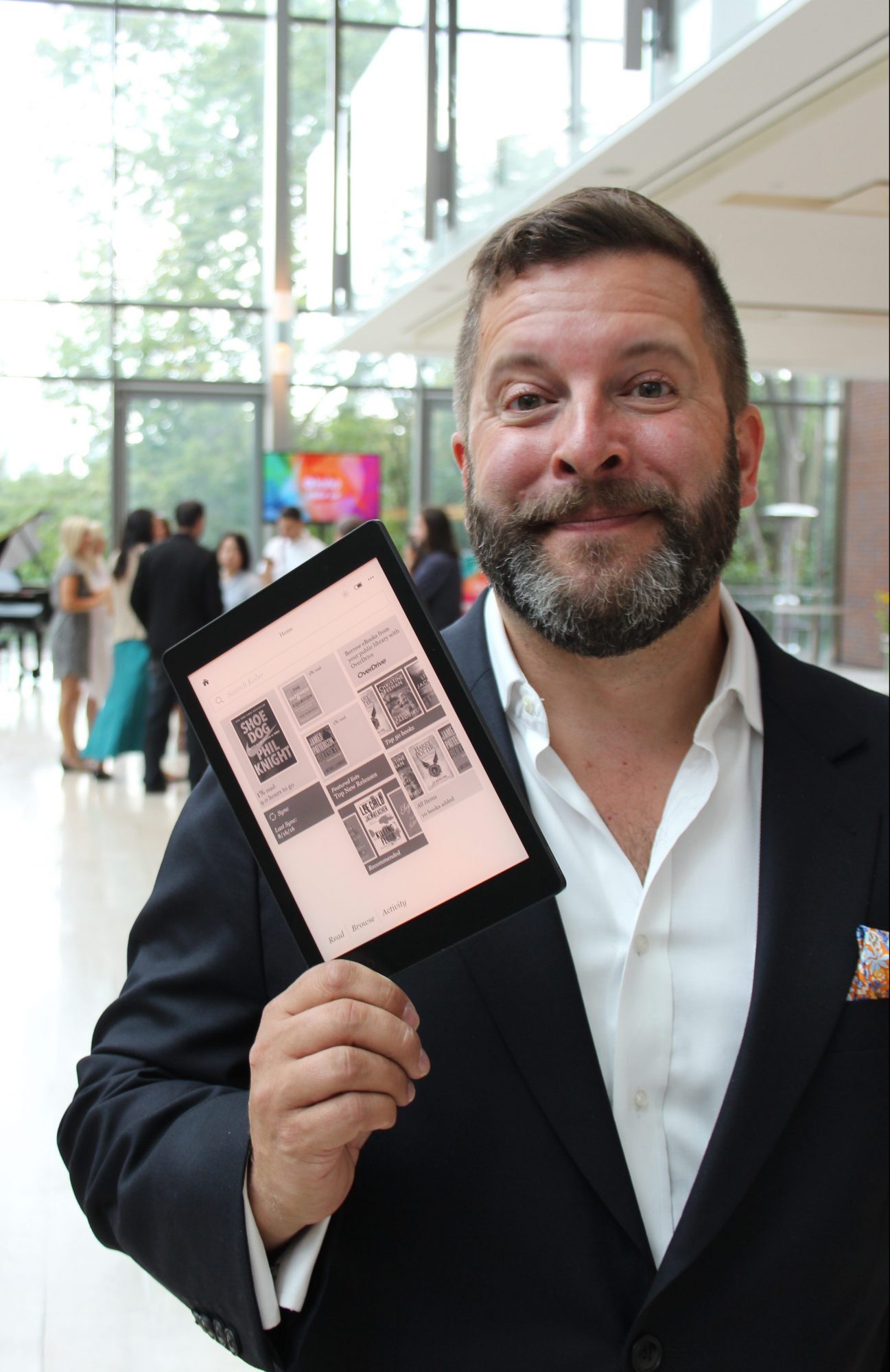Kobo CEO Michael Tamblyn poses with the Kobo Aura One ereader