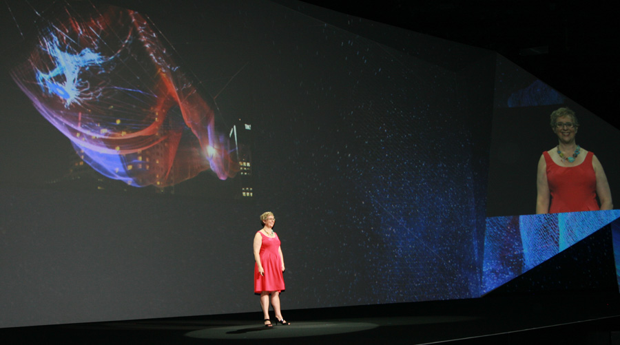 """Sculptor Janet Echelman shows off a picture of her Vancouver sculpture, """"Skies Painted with Unnumbered Sparks,"""" during the Adobe Max conference on Nov. 4."""