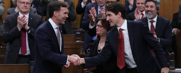 Finance Minister Bill Morneau shakes hands with Prime Minister Justin Trudea ahead of Budget 2017